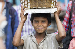 Young boy with a basket on his head Royalty Free Stock Image