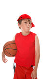 Young boy with basketball. Half portrait of young boy in red top and hat with basketball; isolated on white background Stock Photography