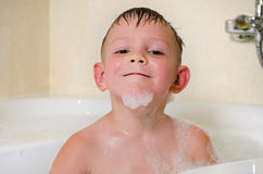 Young boy bathing in the tub Stock Photography