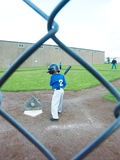 Young boy batting at T-ball. Royalty Free Stock Image