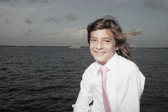 Young boy by the bay Stock Photo