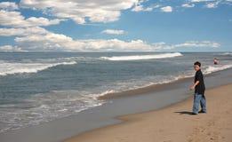 Young boy on beach. Young boy walking along Venice beach in California royalty free stock photography