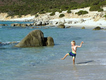 Young boy at the beach. 6 years old young boy is playing at the beach on Sardinia in Italy stock photos