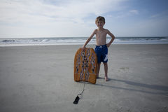 Young Boy at the Beach. With a boogie board Royalty Free Stock Image