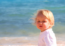 Young boy on beach. Young blond boy on beach stock photography