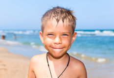 Young boy on the beach Royalty Free Stock Images