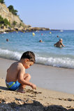 Young boy on the beach. A young boy playing on a beach stock photography