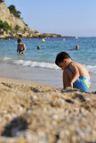 Young boy on the beach. A young boy playing on a beach stock image