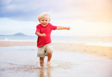 Young boy at the beach Stock Photos