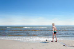 Young Boy on the beach Stock Photo