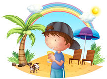 A young boy at the beach with his pet Stock Photos