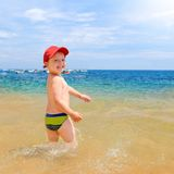 Young boy on beach Stock Image