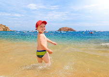 Young boy on beach Stock Images