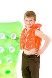 Young boy with beach mattress Royalty Free Stock Photo