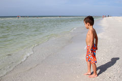 Young boy on a beach Royalty Free Stock Photos