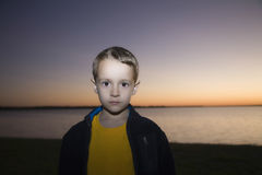 Young Boy On Beach At Sunset Stock Photo
