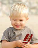 Young boy on the beach with telephone Stock Photography