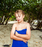 Young boy at the beach uses towel at the beach Royalty Free Stock Photos