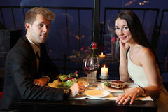 A young boy and girl sitting at the table Stock Photo