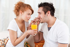 Young boy and a beauty girl drinking ora Royalty Free Stock Image