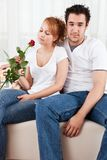 Young boy and a beauty girl with red rose Royalty Free Stock Photography
