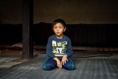 Young boy becomes a novice  at a buddhist temple in Nepal Royalty Free Stock Photography