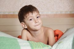 Young boy in bed Royalty Free Stock Photography