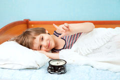 The young boy in bed Royalty Free Stock Photos