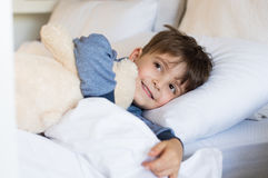 Young boy in bed Royalty Free Stock Image