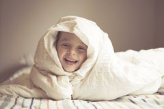 Young Boy on bed Stock Photography
