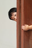 Young boy behind wooden wall Stock Image