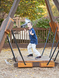Young boy being silly at the park Stock Photo