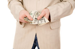 Young boy believes the money. Isolated on white background Royalty Free Stock Image