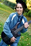 Young boy with beloved guitar Royalty Free Stock Photo