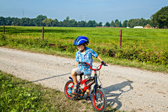 Young boy with bicycle Stock Image
