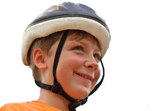 Young Boy with Bicycle Helmet. A young boy wearing his bike helmet, ready to ride royalty free stock photography