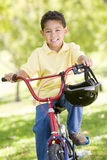Young boy on bicycle outdoors smiling Royalty Free Stock Images