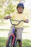Young boy on bicycle outdoors smiling Royalty Free Stock Photography