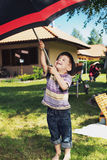 Young boy with big umbrella Stock Photography