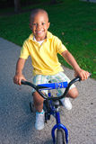Young boy on bike. A young boy poses on his small bike Royalty Free Stock Photos