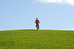 Young boy on bike Stock Images