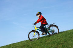Young boy on bike. Ride pedal downhill Stock Image
