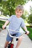 Young boy on a bike Royalty Free Stock Image