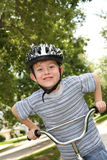 Young boy on a bike Stock Photo