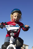 Young Boy on Bike. A young curley blonde haired boy on his first bike Royalty Free Stock Photography