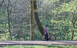 Young boy with bike in park Royalty Free Stock Images
