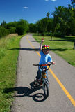 Young Boy on Bike Path Royalty Free Stock Image