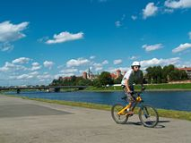 Young boy on the bike on River boulevard Royalty Free Stock Photography