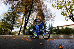 Young boy on a bikeway Stock Images