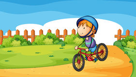 A young boy biking outdoor Stock Images